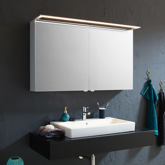 Customised mirror cabinets for your bathroom– example: Modern-Line mirror cabinet with glossy aluminium body, side surfaces in white glass and optionally available GLSU lighting