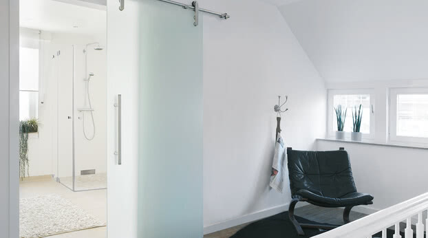Sliding door system Motion 200 as a bathroom door with motif Ravensburg