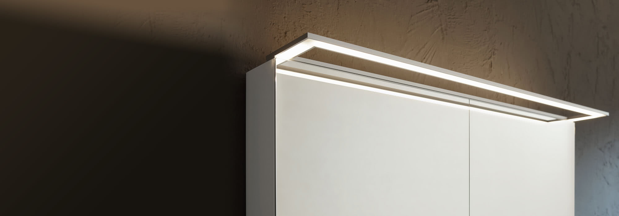 External lighting for mirror cabinet