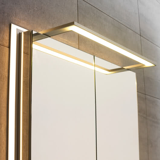 External lighting for mirror cabinets