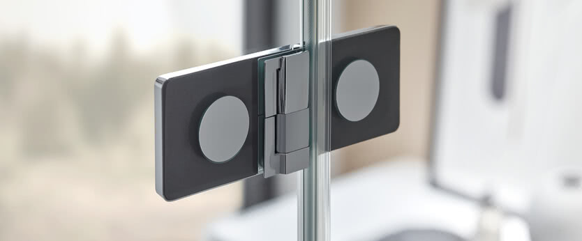 The hinge cover slides sideways over the turning mechanism
