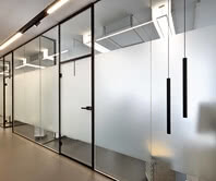 Treatment rooms of a dental office with Aluzarge 100 black framed