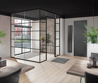 The industrial style becomes a real highlight thanks to a large all-glass system